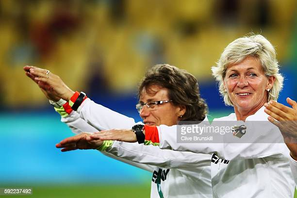 Head coach Silvia Neid of Germany celebrates following the Women's Olympic Gold Medal match between Sweden and Germany at Maracana Stadium on August...