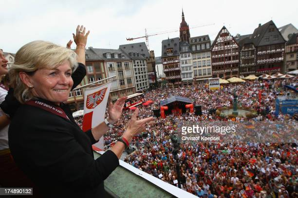 Head coach Silvia Neid of Germany celebrates winning the UEFA Women's EURO 2013 on the balcony of the Roemer on July 29 2013 in Frankfurt am Main...