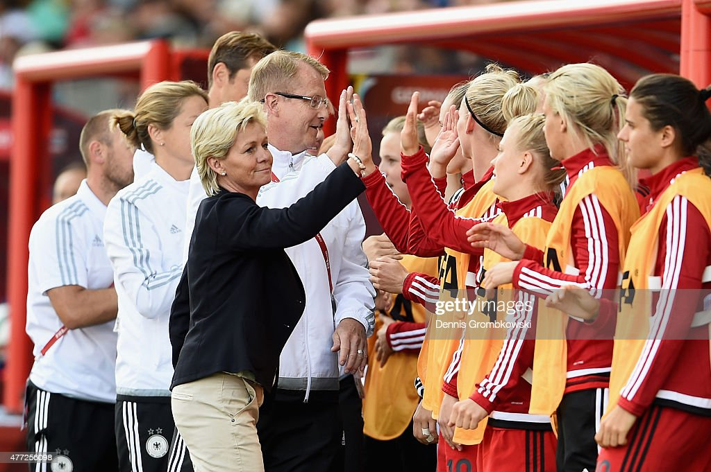 Head coach Silvia Neid of Germany celebrates with her team as Lena Petermann (not in picture) scores the third goal during the FIFA Women's World Cup Canada 2015 Group B match between Thailand and Germany at Winnipeg Stadium on June 15, 2015 in Winnipeg, Canada.