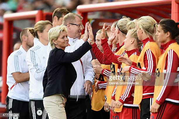 Head coach Silvia Neid of Germany celebrates with her team as Lena Petermann scores the third goal during the FIFA Women's World Cup Canada 2015...