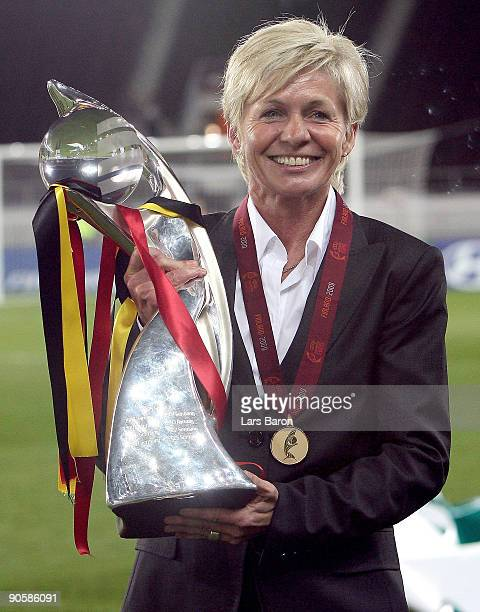 Head coach Silvia Neid of Germany celebrates with the trophy after winning the UEFA Women's Euro 2009 Final match between England and Germany at the...
