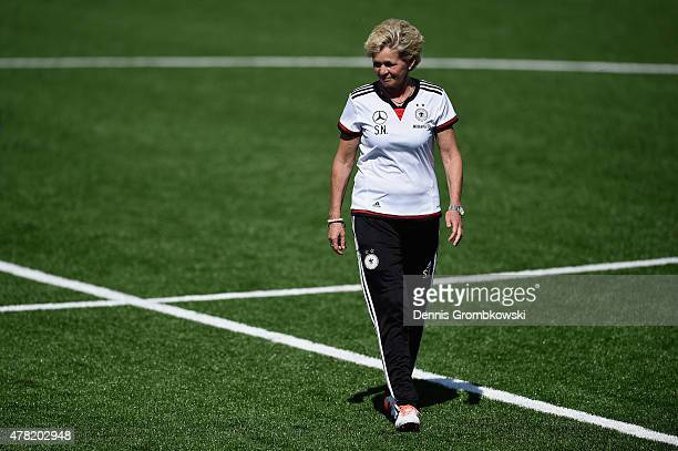 Head coach Silvia Neid of Germany looks on during a training session at Complexe Sportif Multi Sports on June 23 2015 in Montreal Canada