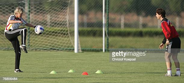 Head coach Silvia Neid of Germany shoots the ball to her assistant coach Maren Meinert uring the Women's German National Team training session on the...