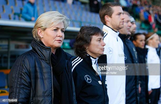 Head coach Silvia Neid of Germany sings the national anthem prior to the FIFA Women's World Cup 2015 Qualifier between Slovakia and Germany at...