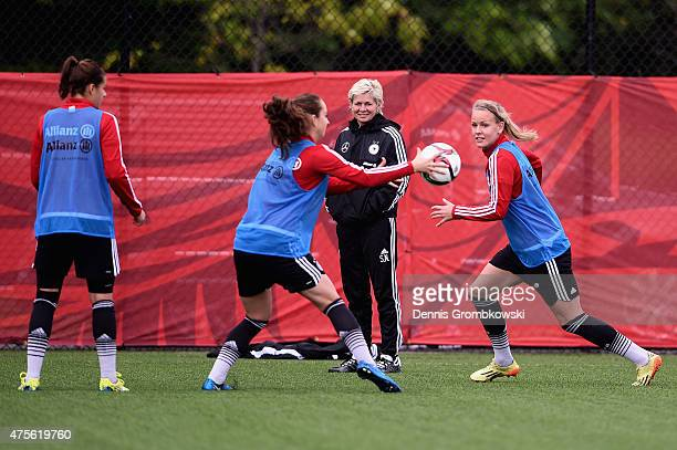 Head coach Silvia Neid of Germany watches her team practicing during a morning traning session at Richcraft Recreation Complex on June 2 2015 in...