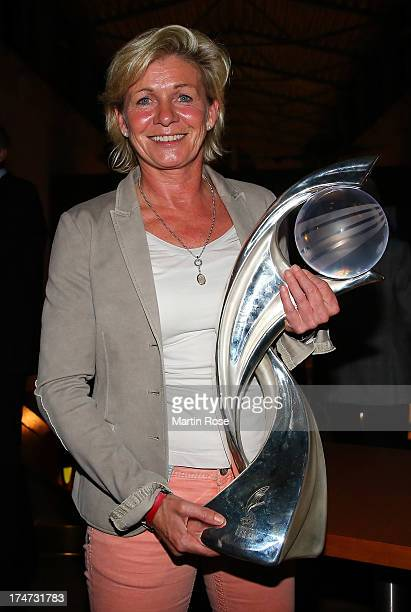 Head coach Silvia Neid poses with the UEFA Women's Euro Winners trophy during the Champions party after winning the UEFA Women's Euro final against...