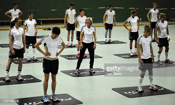 Head coach Silvia Neid smiles during a German Women National Team training session at NetCologne Stadium on April 20 2011 in Cologne Germany