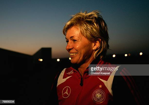Head coach Silvia Neid talks after the Women's German National Team training session on the training ground at the Wuhan Sports Center Stadium on...
