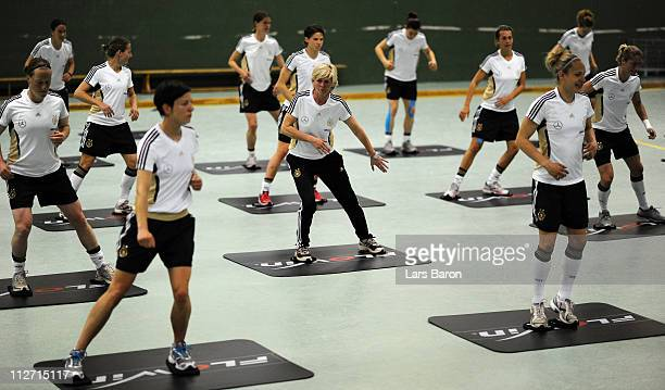 Head coach Silvia Neid warms up during a German Women National Team training session at NetCologne Stadium on April 20 2011 in Cologne Germany