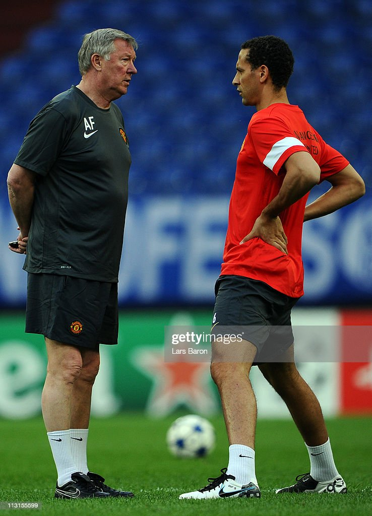Head coach Sir Alex Ferguson speaks with Rio Ferdinand during a Manchester United training session ahead of the UEFA Champions League semifinal first leg match against FC Schalke 04 at Veltins Arena on April 25, 2011 in Gelsenkirchen, Germany.