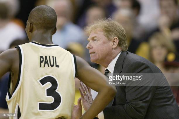 Head coach Skip Prosser of the Wake Forest Demon Deacons talks to his point guard Chris Paul during the game against the University of Maryland...