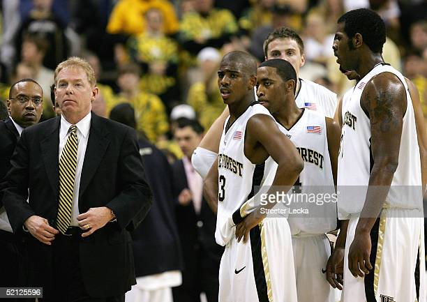 Head coach Skip Prosser stands with Chris Paul of the Wake Forest Demon Deacons and the rest of his team during their game against the Duke Blue...