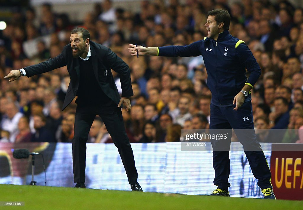Head Coach Slaven Bilic of Besiktas and Manager Mauricio Pochettino of Spurs on the touchline during the UEFA Europa League Group C match between Tottenham Hotspur FC and Besiktas JK at White Hart Lane on October 2, 2014 in London, United Kingdom.