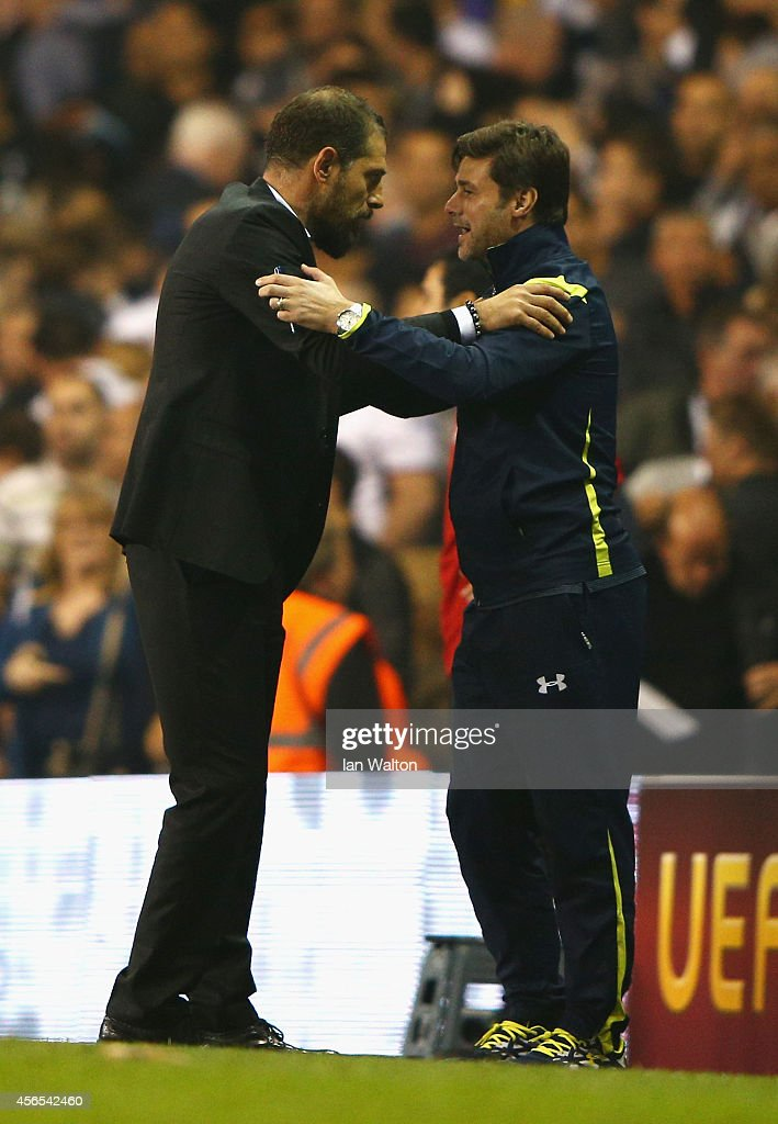 Head Coach Slaven Bilic of Besiktas with Manager Mauricio Pochettino of Spurs at the final whistle during the UEFA Europa League Group C match between Tottenham Hotspur FC and Besiktas JK at White Hart Lane on October 2, 2014 in London, United Kingdom.