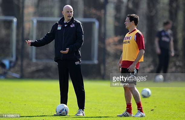 Head coach Stale Solbakke gives instructions to Sascha Riether during a 1. FC Koeln training session at Geissbockheim on March 22, 2012 in Cologne,...