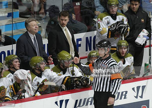 Head Coach Stan Butler of the Brampton Battalion pleads with referee Scott Hoberg after a call against the Windsor Spitfires during Game 5 of the OHL...