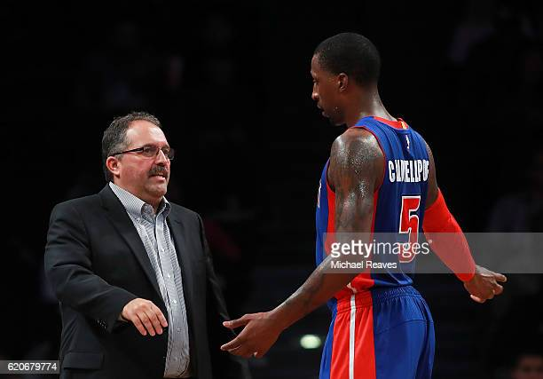 Head coach Stan Van Gundy of the Detroit Pistons talks with Kentavious CaldwellPope against the Brooklyn Nets during the second half at Barclays...