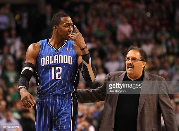 Head Coach Stan Van Gundy talks to Dwight Howard of the Orlando Magic during the game against the Boston Celtics on January 23 2012 at the TD Garden...