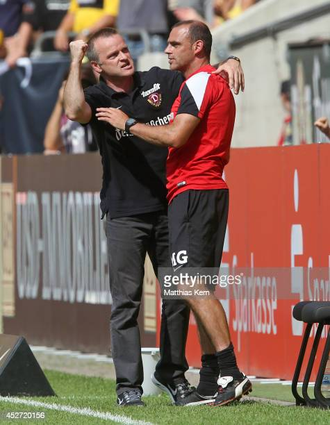 Head coach Stefan Boeger of Dresden and assistant coach Marco Gebhardt show their delight after winning the third league match between SG Dynamo...