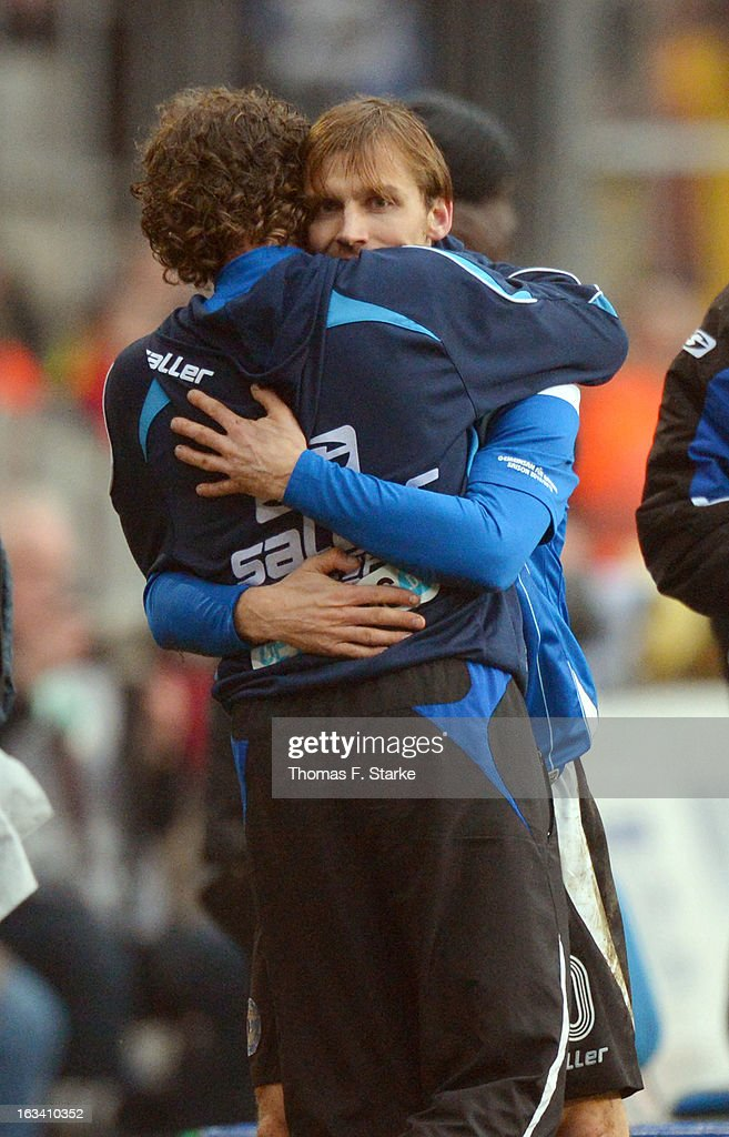 Head coach Stefan Kraemer (L) of Bielefeld celebrates with Sebastian Hille during the Third League match between Arminia Bielefeld and Preussen Muenster at Schueco Arena on March 9, 2013 in Bielefeld, Germany.