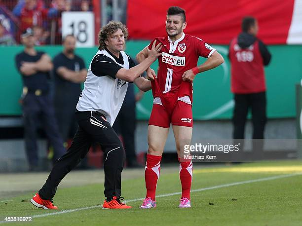 Head coach Stefan Kraemer of Cottbus and Fanol Perdedaj look on during the DFB Cup match between FC Energie Cottbus and Hamburger SV at Stadion der...
