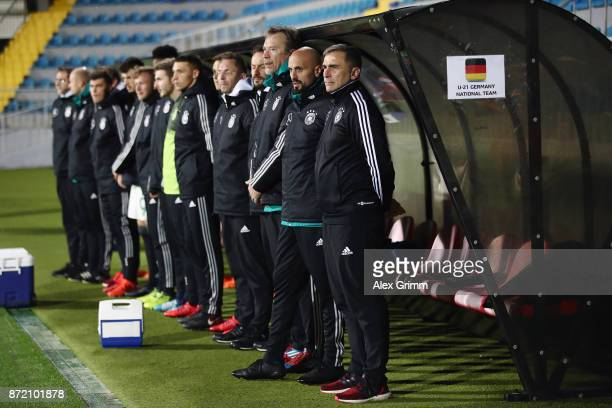 Head coach Stefan Kuntz of Germany and team members stand together prior to the UEFA Under21 Euro 2019 Qualifier match between Azerbaijan U21 and...