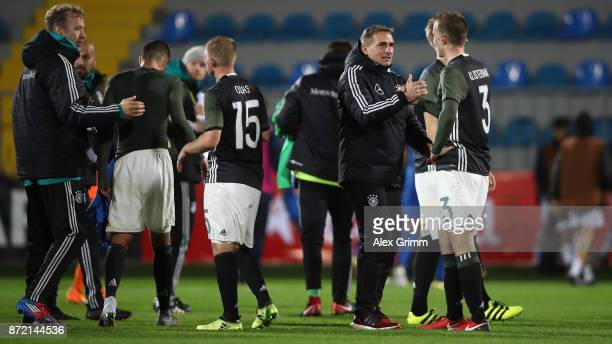 Head coach Stefan Kuntz of Germany shakes hands with Lukas Klostermann after the UEFA Under21 Euro 2019 Qualifier match between Azerbaijan U21 and...