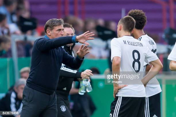 Head coach Stefan Kuntz of Germany speak with Maximilian Eggestein of Germany und Thilo Kehrer of Germany during the U21 UEFA 2018 EM Qualifying...