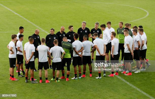 Head coach Stefan Kuntz of Germany talks to his team during the MD1 training session of the U21 national team of Germany at Krakow stadium on June 29...