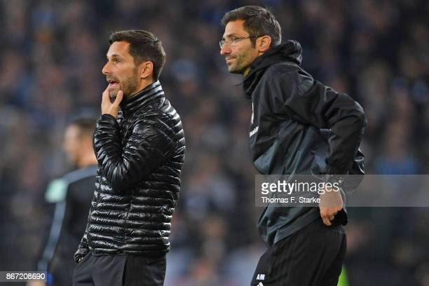 Head coach Stefan Leitl and assistant coach Andre Mijatovic of Ingolstadt look on during the Second Bundesliga match between DSC Arminia Bielefeld...