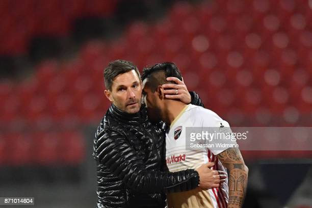 Head coach Stefan Leitl of FC Ingolstadt 04 hugs Dario Lezcano during the Second Bundesliga match between 1 FC Nuernberg and FC Ingolstadt 04 at...