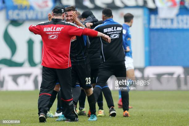 Head coach Steffen Baumgart of Paderborn and his team show their delight after winning the 3Liga match between FC Hansa Rostock and SC Paderborn 07...