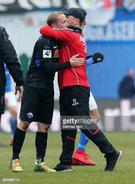 Head coach Steffen Baumgart of Paderborn and Sven Michel show their delight after winning the 3Liga match between FC Hansa Rostock and SC Paderborn...
