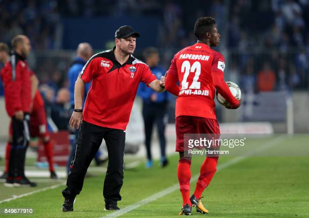 Head coach Steffen Baumgart of Paderborn argues with Christopher AntwiAdjej of Paderborn during the 3 Liga match between 1 FC Magdeburg and SC...