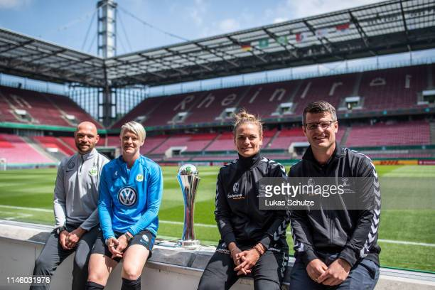 Head coach Stephan Lerch and Nilla Fischer of VfL Wolfsburg pose with the trophy and Clara Schoene and Head coach Jens Scheuer of SC Freiburg after...