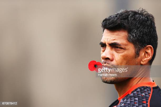 Head coach Stephen Kearney holds an ANZAC poppy during a New Zealand Warriors NRL training session at Mt Smart Stadium on April 21 2017 in Auckland...