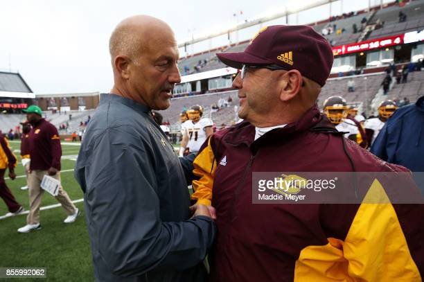 Head coach Steve Addazio of the Boston College Eagles and head coach John Bonamego of the Central Michigan Chippewas shake hands after the Eagles...