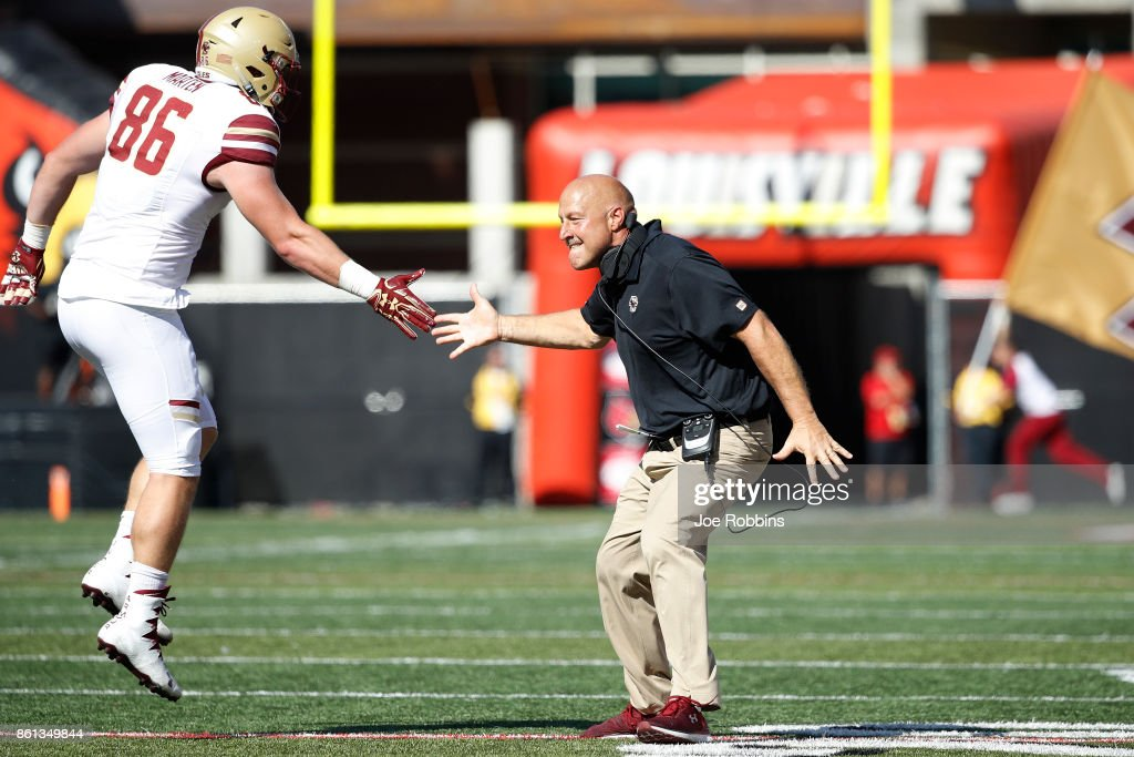 Head coach Steve Addazio of the Boston College Eagles celebrates with Ray Marten #86 after a touchdown in the third quarter of a game against the Louisville Cardinals at Papa John's Cardinal Stadium on October 14, 2017 in Louisville, Kentucky. Boston College won 45-42.