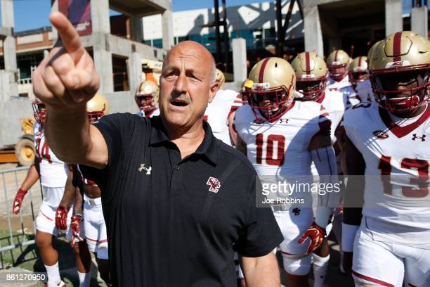 Head coach Steve Addazio of the Boston College Eagles takes his team to the field before a game against the Louisville Cardinals at Papa John's...