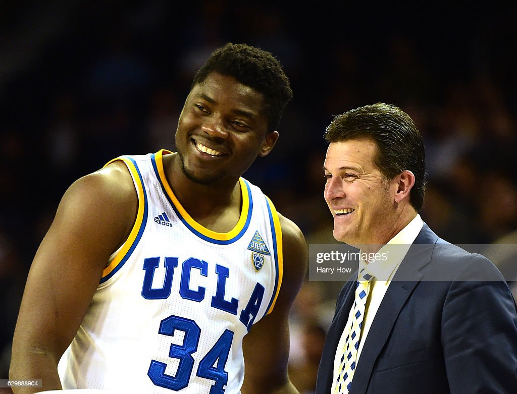 Head coach Steve Aford of the UCLA Bruins laughs with Ikenna Okwarabizie #34 during a 102-62 win over the UC Santa Barbara Gauchos at Pauley Pavilion on December 14, 2016 in Los Angeles, California.