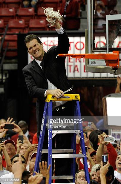 Head coach Steve Alford of the New Mexico Lobos cuts down the net after defeating the San Diego State Aztecs 6859 to win the championship game of the...