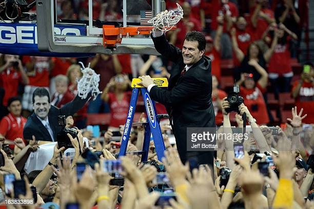 Head coach Steve Alford of the New Mexico Lobos cuts down the net after defeating the UNLV Rebels 6356 to win the the championship game of the...