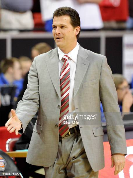 Head coach Steve Alford of the New Mexico Lobos greets players before his team's 8776 loss to the Brigham Young University Cougars in a semifinal...