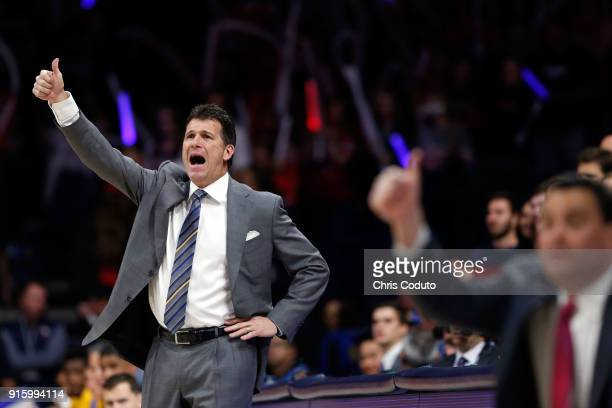 Head coach Steve Alford of the UCLA Bruins and head coach Sean Miller of the Arizona Wildcats gesture during the second half of the college...