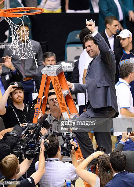 Head coach Steve Alford of the UCLA Bruins cuts down a net after defeating the Arizona Wildcats 7571 in the championship game of the Pac12 Basketball...