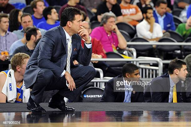 Head Coach Steve Alford of the UCLA Bruins looks on against the Gonzaga Bulldogs during the South Regional Semifinal round of the 2015 NCAA Men's...