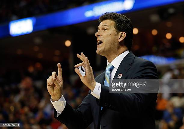 Head coach Steve Alford of the UCLA Bruins motions to his players during a regional semifinal of the 2014 NCAA Men's Basketball Tournament against...