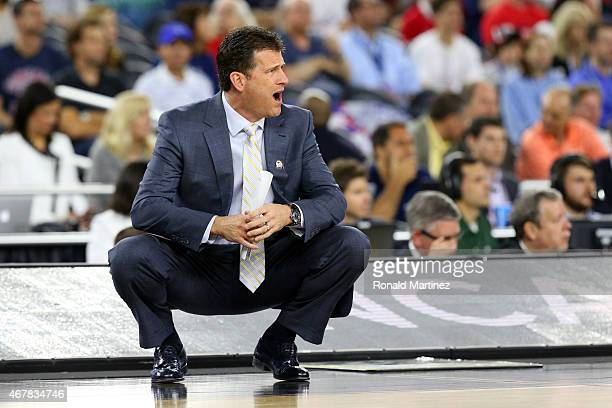 Head coach Steve Alford of the UCLA Bruins reacts against the Gonzaga Bulldogs during a South Regional Semifinal game of the 2015 NCAA Men's...