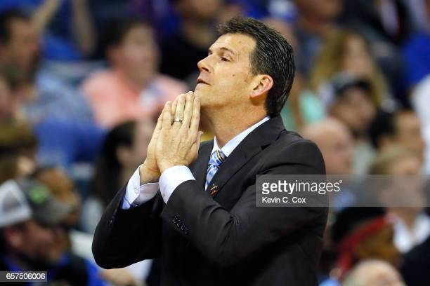 Head coach Steve Alford of the UCLA Bruins reacts in the second half against the Kentucky Wildcats during the 2017 NCAA Men's Basketball Tournament...