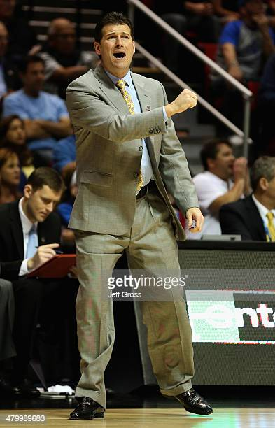 Head coach Steve Alford of the UCLA Bruins signals to his team while they play the Tulsa Golden Hurricane during the second round of the 2014 NCAA...